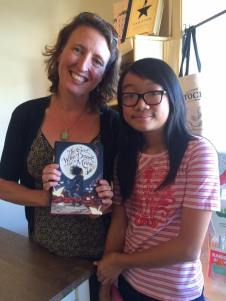 This year's Newbery Medalist visiting the shop, pictured with Let's Play Books patron Annette.